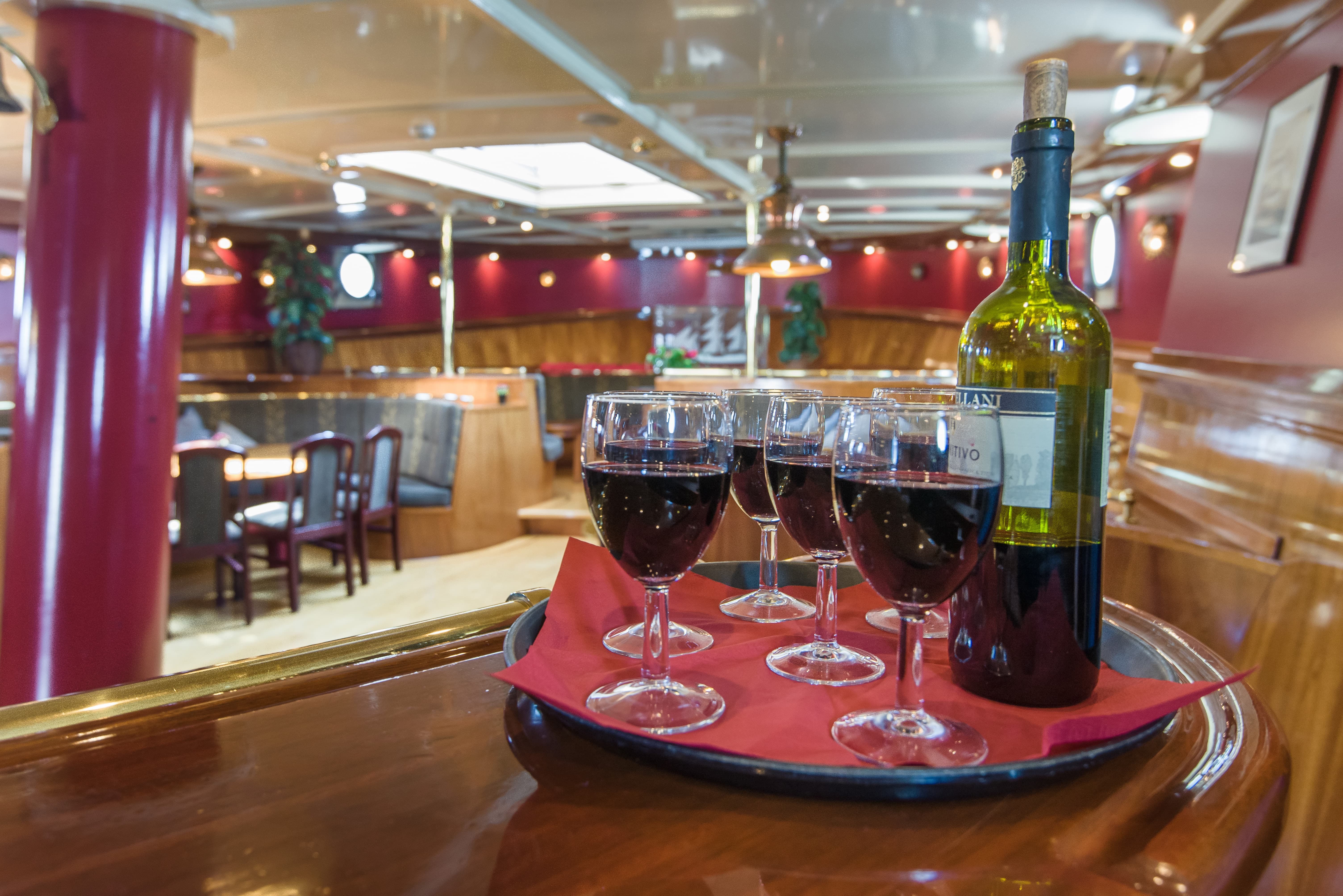 Enjoy a glass of wine on board from Artemis