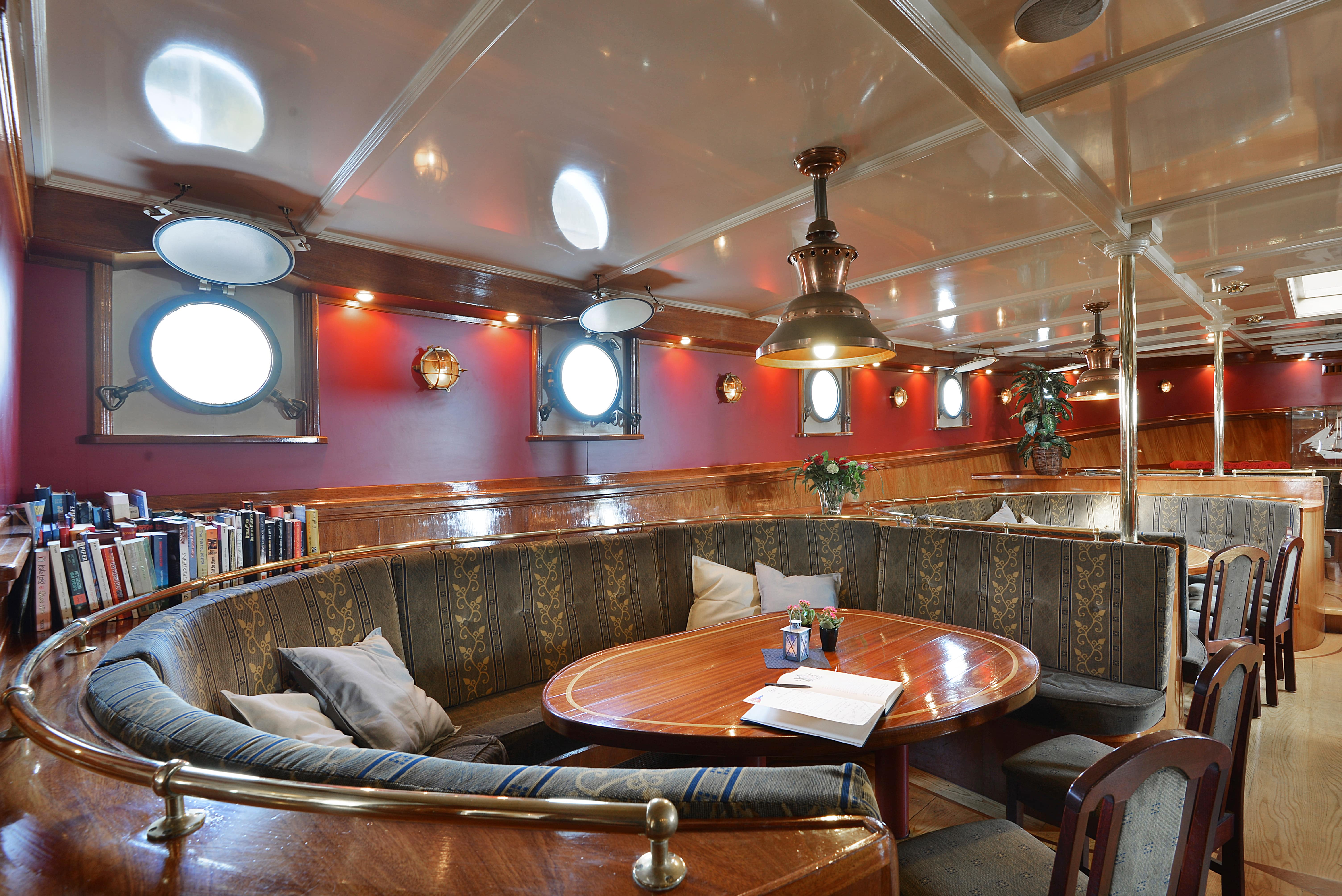 Cozy sitting areas on sailing vessel Artemis